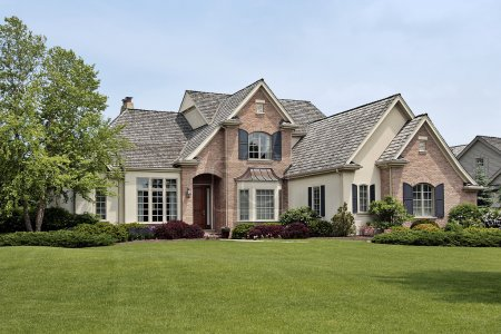 Photo for Large luxury brick home in suburban setting - Royalty Free Image