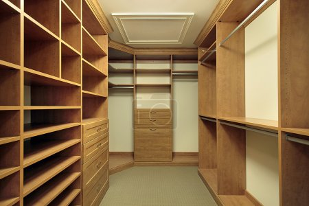 Photo for Large master bedroom closet with wood paneling - Royalty Free Image