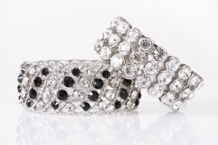 Silver bracelets on a white background...