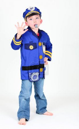 Young boy dressed up as a police officer