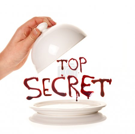 Photo for Hand taking off a lid of an empty tray with bloody letters Top Secret - Royalty Free Image