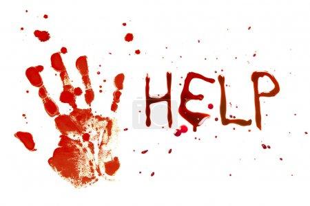 Foto de Sangrienta huella de una mano sangrante sobre un fondo blanco con la ayuda de cartas - Imagen libre de derechos