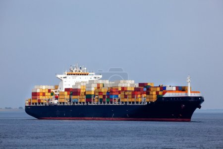 Photo for Huge container ship passing - all brand names removed from every container - Royalty Free Image