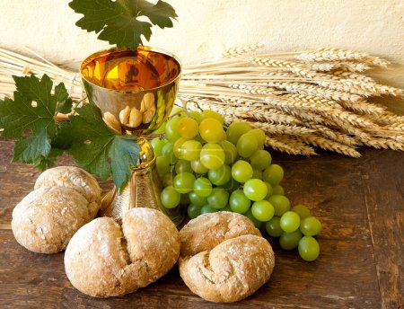 Photo for Grapes and holy bread next to a golden chalice with wine - Royalty Free Image