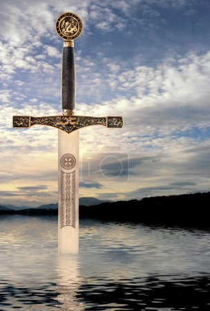 Medieval sword rising from the waters of a Scottis...