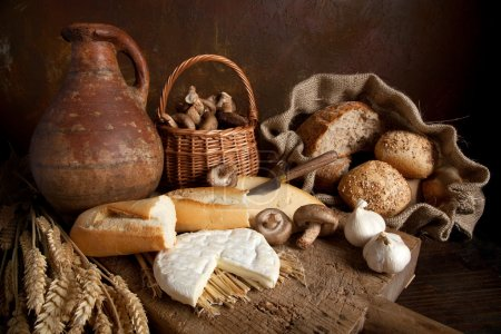 Photo for Country still life with bread, cheese, mushrooms and wine in an antique jar - Royalty Free Image