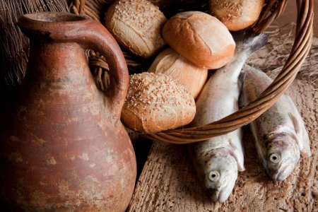 Photo for Religious still life of 5 loaves of bread, an antique wine jug and 2 fish - Royalty Free Image