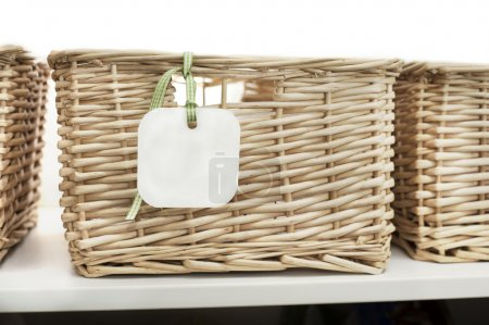 Storage basket with tag