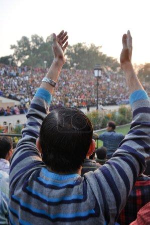 Indian celebrating during the border closing cerem...