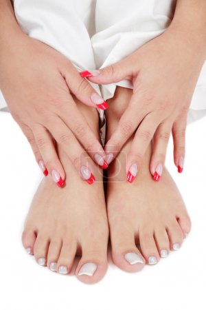 Photo pour Close-up shot of woman's hand and feet with stylish manicure and pedicure - image libre de droit