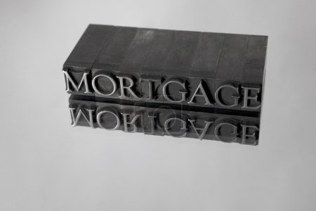 Mortgage spelled with Metal Type Reflection
