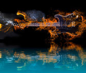 Burning Electric Guitar with reflection in water