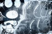 Graffiti přes starou špinavou zeď, urban hip hop šedé pozadí textu