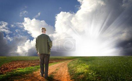 Old man walking his way