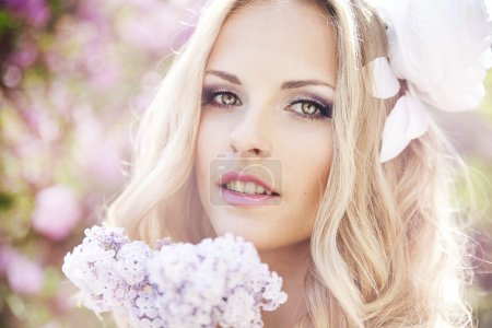 Photo for Beautiful woman with flowers of lilac. Skincare - Royalty Free Image