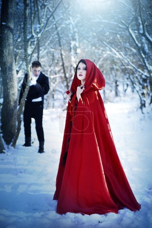 Red Riding Hood in the woods with a man-wolf