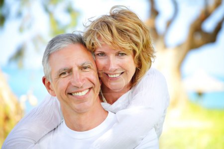 Photo for Close-up portrait of a mature couple smiling and embracing. Focus on the woman. - Royalty Free Image