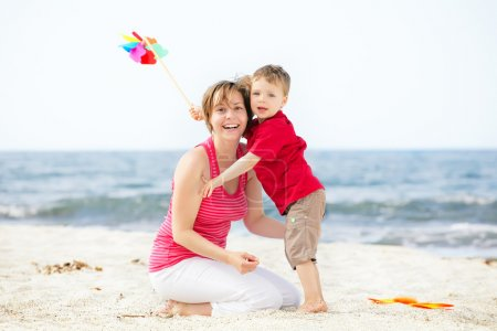 Photo for Mother and son having fun on the beach. - Royalty Free Image
