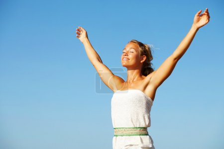 Photo for Beautiful young woman with arms raised. - Royalty Free Image