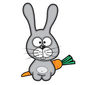 Funny white rabbit with a carrot