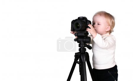 A child with a camera in the studio