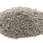 Growmore fertiliser in a heap on a white backgroun...