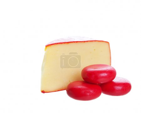 Photo for Red waxed gourmet cheeses on a white background. - Royalty Free Image