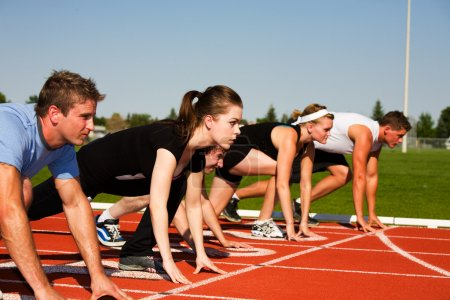 Photo for Five runners lined up ready to race. Selective focus on second runner. - Royalty Free Image