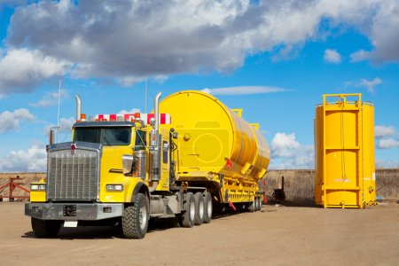 Yellow Transport With Oilfield Tanks