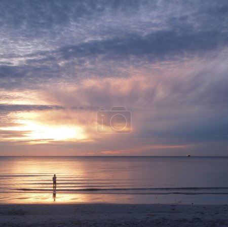 Photo for Young man and sunset on sea,showing lonely concept. - Royalty Free Image