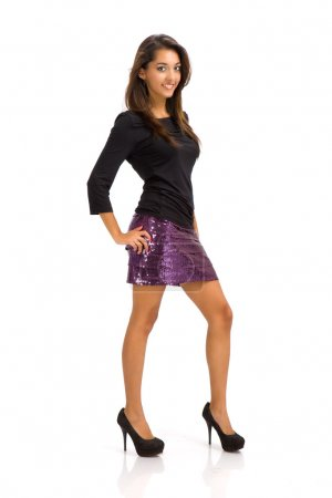 Portrait of a stunning young woman posing in short skirt and long sleeves b