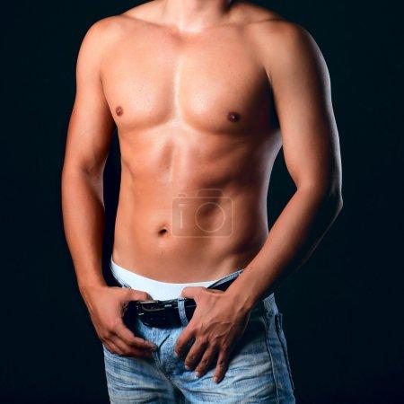 Sunburnt muscular male torso