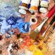 Artistic equipment: paint, brushes, spatula and ar...