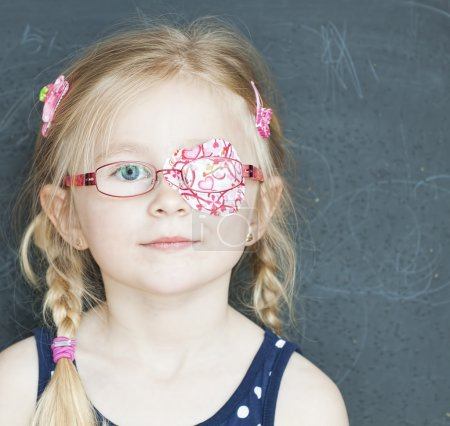School child with medicine plaster