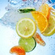 Tropical fruits are falling deeply under water wit...