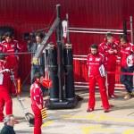 Постер, плакат: Fernando Alonso ESP talking to Ferrari mechanic