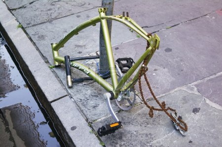 Photo for Bicycle stripped while locked to a pole - Royalty Free Image
