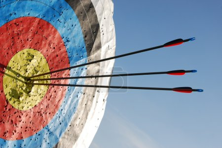 Photo for Three arrows in the centre of an archery target to show success and accuracy - Royalty Free Image