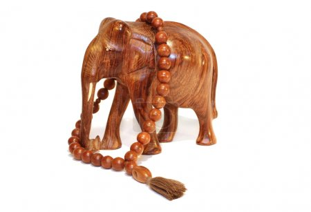 A wooden elephant and wooden beeds