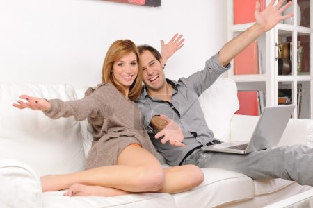 Couple smiling opening arms