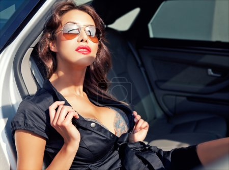 Sexy business woman in the car