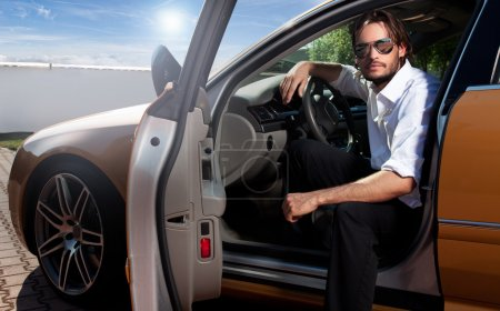 Portrait of business man inside the car