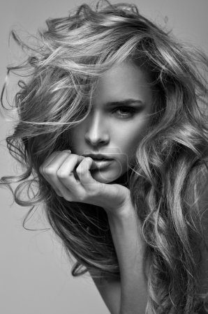 Black and white vogue style portrait of delicate blonde woman