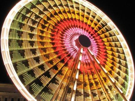 Long exposure of a Ferris Wheel ride at night