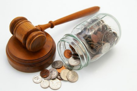 Photo for Legal court gavel and money from a coin jar - Royalty Free Image