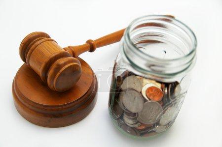 Gavel and coin jar