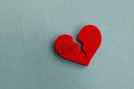 Photo for Red broken heart, closeup on blue - Royalty Free Image
