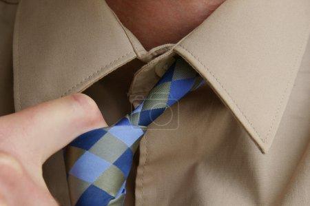 Man loosening tie