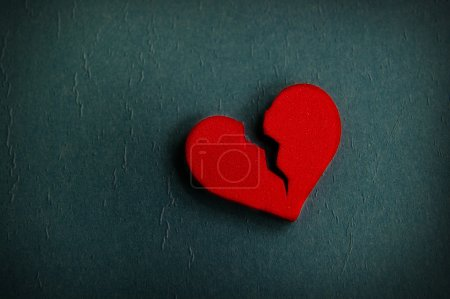 Photo for Red broken heart shape, on textured blue - Royalty Free Image
