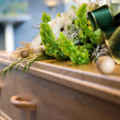 A coffin with a flower arrangement at a mortuary...